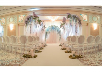 White wedding arch. Decorated with flowers of lilac